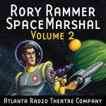 Rory Rammer, Volume 02 graphic depicting Rory Rammer, holding a ray gun, with a rocket ship in the background