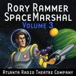 Rory Rammer, Volume 03 graphic depicting Rory Rammer, holding a ray gun, with a rocket ship in the background